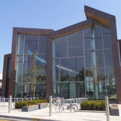 Design of cladding copper and timber supports at a leisure centre.